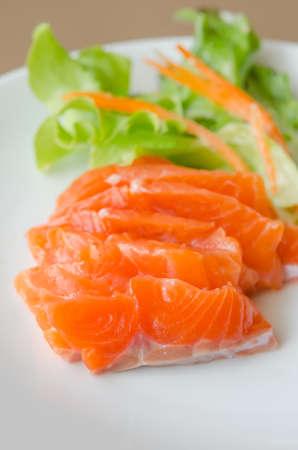 salmon sashimi with fresh salad , japanese style cuisine photo