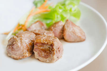 grilled pork meat with fresh salad on a plate photo