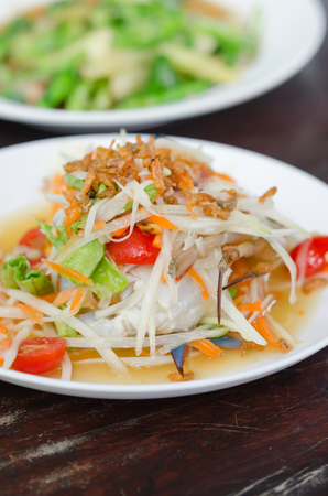 spicy papaya salad with crab , asian spicy food photo