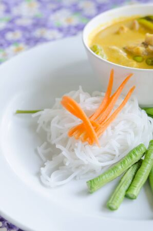 vermicelli: Thai rice vermicelli served with yellow curry Stock Photo