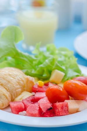 mix fruit: A breakfast croissant with mix fruit salad
