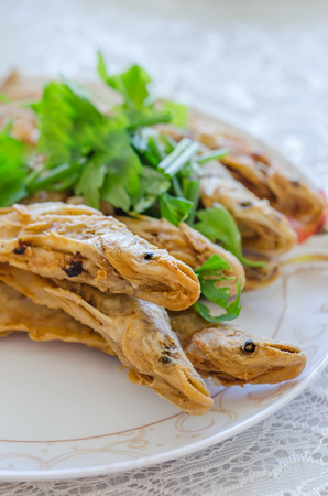sheatfish: Fried river fish with garlic and pepper