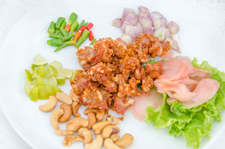 tendon: Deep fried sour fermented chicken knees tendon served with vegetables  sliced Stock Photo