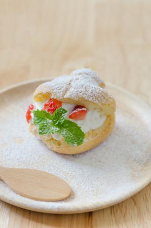 choux: fresh strawberry Choux Cream on wooden dish