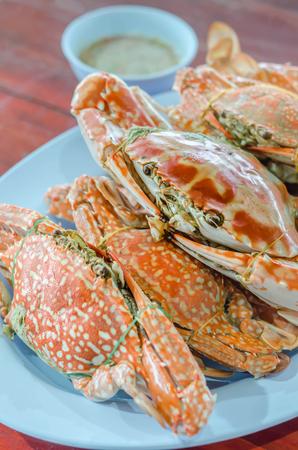 crab legs: steamed flower crab or blue crab, blue manna crab, sand crab