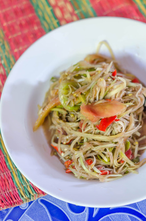 somtum: Famous Thai food, spicy papaya salad or Somtum in Thai Stock Photo