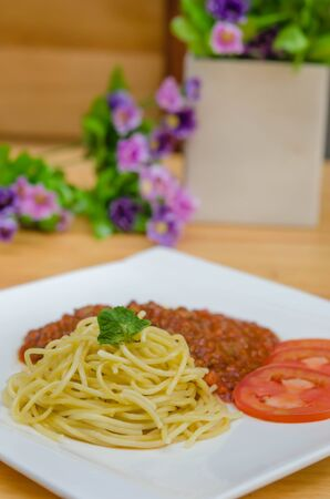 pasta: Spaghetti Bolognese meal with basil leaves and tomatoes