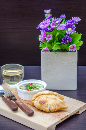 chili sauce: Curry puff pastry with sweet sauce  on wooden plate Stock Photo