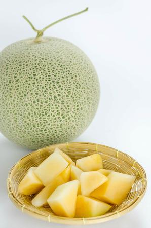 Cantaloupe: freshly cut cantaloupe melon on white background Stock Photo