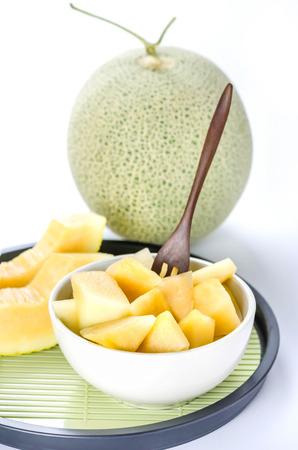 freshly cut cantaloupe melon on white background Stock Photo