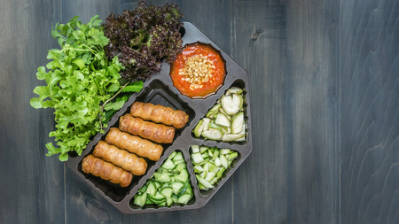 top view of roasted pork served with spicy sauce and vegetable (Nam Neung) on wooden background