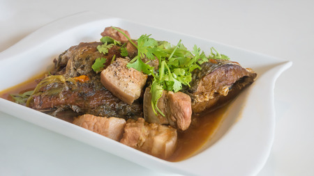 stewed pork and fish with herb , vietnamese style food Stock Photo