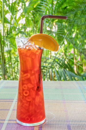 iced orange tea  on table with nature background