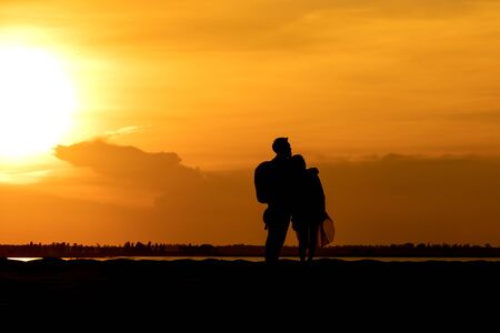 Silhouette traveler couples on mountain at sunset times