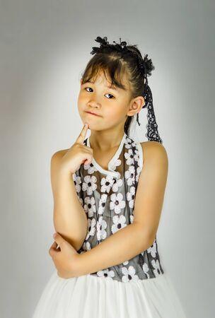 Portrait of asian little girl in black and white dress Foto de archivo - 128099021