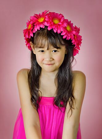 Portrait of asian little  girl in pink dress Foto de archivo - 128099450