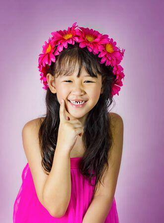 Portrait of asian little  girl in pink dress Foto de archivo - 128099648