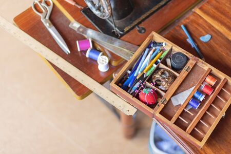sewing tools and reels of color thread on table. Handmade clothes dressmaking and sewing Concept