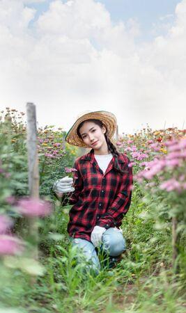 Beautiful asian woman holding bouquet flowers , Portrait in nature field. happy farmers