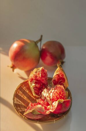 Pomegranate Fruit and wooden basket with sunlight