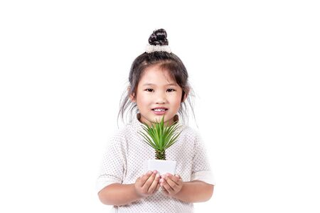portrait of asian little girl  with green plant over white background Banco de Imagens