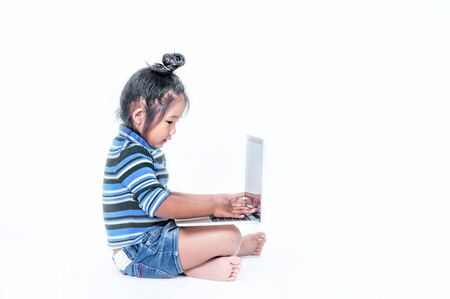 portrait of asian little girl  with laptop over white background