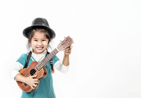 portrait of asian little girl with ukulele over white background Banco de Imagens - 150448050