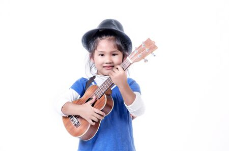 portrait of asian little girl with ukulele over white background