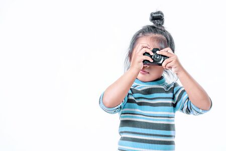 portrait of asian little girl taking a photograph over white background