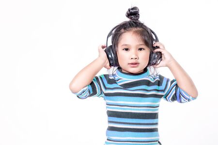 portrait of asian little girl with headphone over white background Banco de Imagens