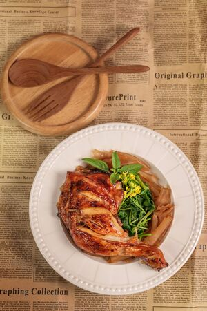 grilled chicken with shanghai noodles and vegetables on white dish