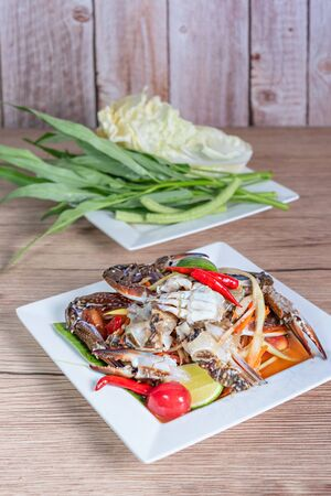 Traditional thai cuisine spicy green papaya salad with crab