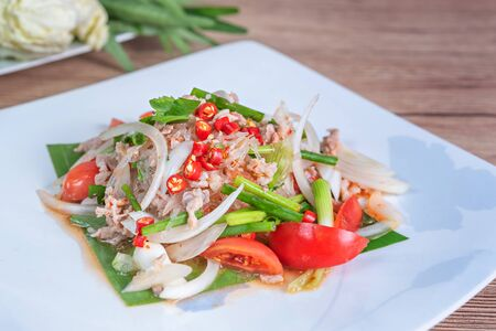 spicy salad with minced pork ,vermicelli and fresh vegetables , Thai style food