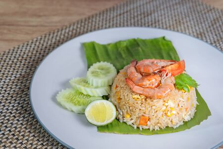 fried rice with prawn served with fresh vegetables on dish