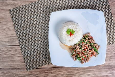 steamed rice and  minced pork fried with chili pepper and  sweet basil
