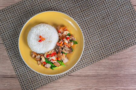 steamed rice and spicy crispy pork fried with chili pepper and kale Banco de Imagens