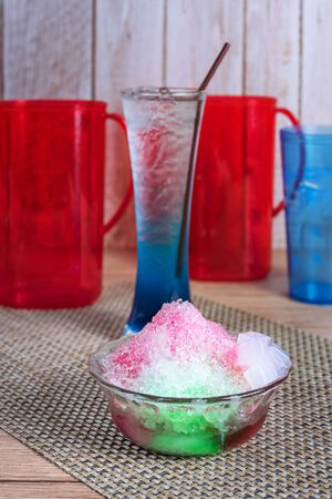 Sweet homemade shaved colorful ice dessert in a bowl