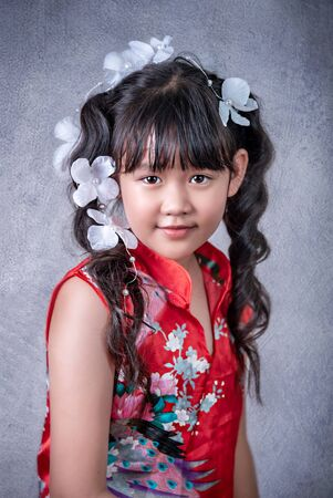 Portrait of asian little  girl in red dress