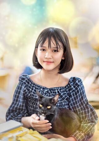 portrait of asian girl with her black cat