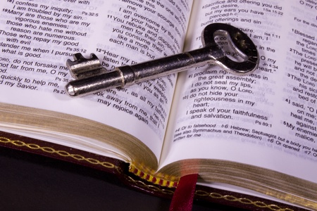 Open Holy Bible and Key Stock Photo