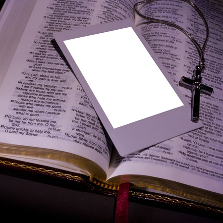 religious text: Open Holy Bible with photo and cross