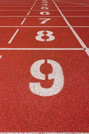 Number on a Red Running Track  Stock Photo