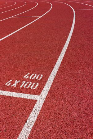 4 x 100 Curve of a Red Running Track  Stock Photo