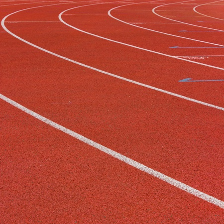 Curve of a Red Running Track  photo