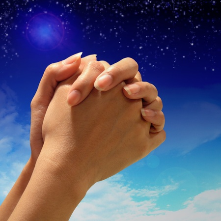 prayer: Prayer Hand to above night sky background Stock Photo