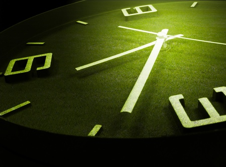 Clock with green grass background