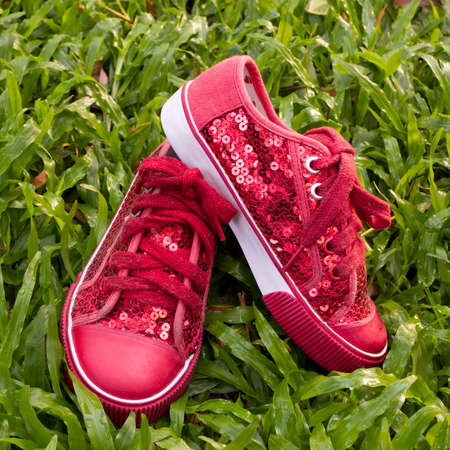 red shoes on green grass photo