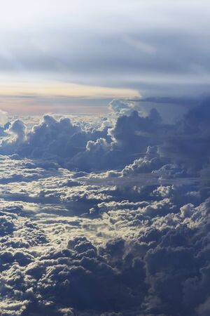 bird eye view: a dramatic beautiful sunset and cloud shot from above background