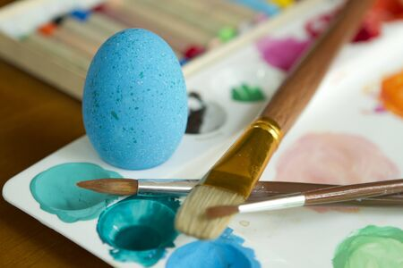 Painting colorful easter egg