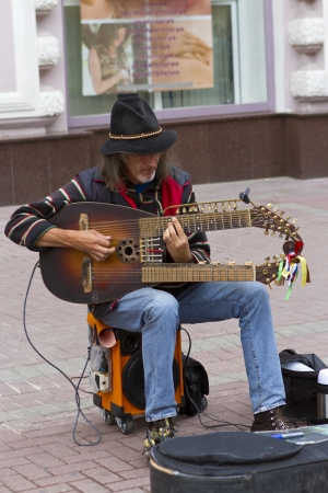 traditinal: A solo russia traditinal instruments musician on Tverskoy Blvd, shopping steet in Moscow, Russia Editorial